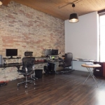Back office shows exposed brick
